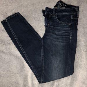 Dark wash skinny jeans.